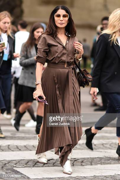 Guest is seen wearing a brown Chloe dress outside the Chloe show during Paris Fashion Week SS20 on September 26, 2019 in Paris, France.