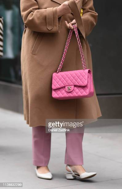 A guest is seen wearing a brown coat and Chanel bag outside the Tibi show during New York Fashion Week Fall/Winter 2019 on February 10 2019 in New...