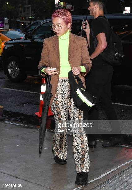 A guest is seen wearing a brown coat green turtle neck and snake skin pants outside the Prabal Gurung show during New York Fashion Week Women's S/S...
