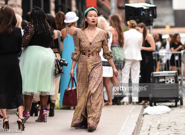 Guest is seen wearing a brown Cynthia Rowley dress and green headpiece outside the Cynthia Rowley show during New York Fashion Week S/S20 on...
