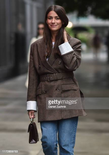 Guest is seen wearing a brown jacket and blue jeans outside the Rag & Bone show during New York Fashion Week S/S20 on September 06, 2019 in New York...