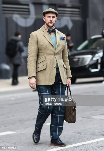A guest is seen wearing a brown sports jacket with blue striped pants outside of the Rochambeau show during New York Fashion Week Men's AW17 on...