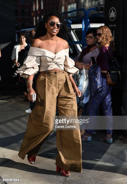 A guest is seen wearing a brown top and pants outside the DVF show during New York Fashion Week Women's S/S 2018 on September 10 2017 in New York City