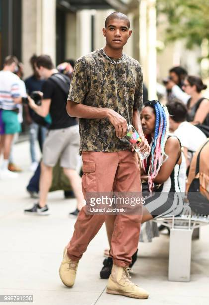 Guest is seen wearing a camo t-shirt and pink pants outside the Death to Tennis show during the 2018 New York City Men's Fashion Week on July 11,...
