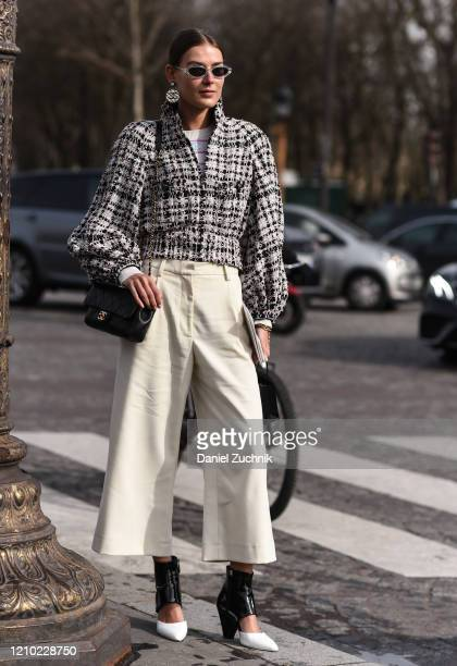 Guest is seen wearing a Chanel outfit with shoes outside the Chanel show during Paris Fashion Week: AW20 on March 03, 2020 in Paris, France.