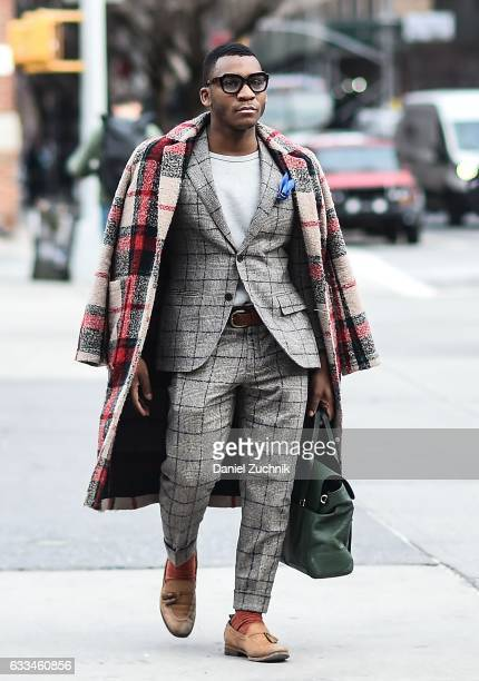 A guest is seen wearing a checkered coat and checkered suit outside of the Rochambeau show during New York Fashion Week Men's AW17 on February 1 2017...