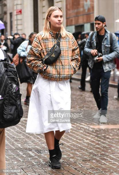 A guest is seen wearing a checkered coat and white skirt outside the Tibi show during New York Fashion Week Women's S/S 2019 on September 9 2018 in...