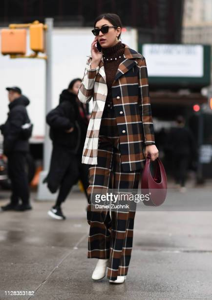 A guest is seen wearing a checkered suit outside the Brock Collection show during New York Fashion Week Fall/Winter 2019 on February 08 2019 in New...