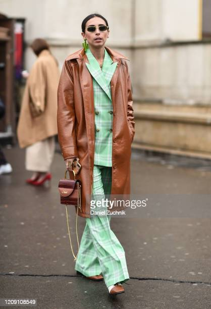 A guest is seen wearing a Chloe outfit with bag outside the Ann Demeulemeester show during Paris Fashion Week AW20 on February 27 2020 in Paris France