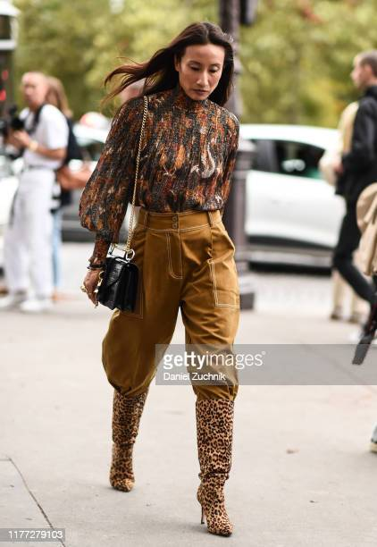 A guest is seen wearing a Chloe top and brown pants with leopard print boots outside the Chloe show during Paris Fashion Week SS20 on September 26...