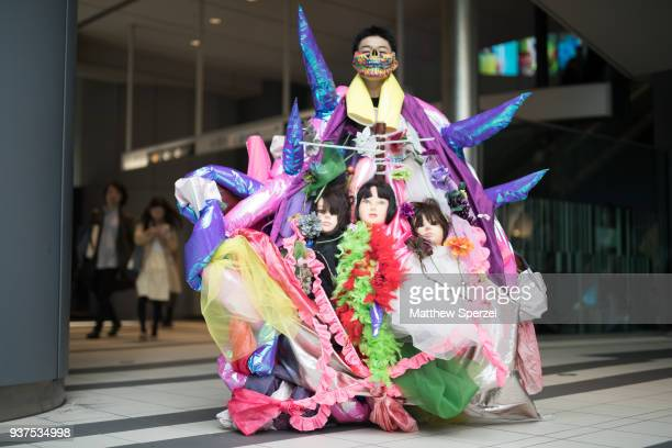 A guest is seen wearing a coloful avant garde outfit with face mask and mannequin heads during the Amazon Fashion Week TOKYO 2018 A/W on March 24...