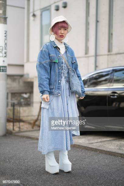 A guest is seen wearing a denim jacket with baby blue dress and platform shoes during the Amazon Fashion Week TOKYO 2018 A/W on March 23 2018 in...