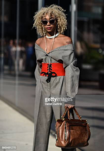 A guest is seen wearing a DVF dress and belt outside the DVF show during New York Fashion Week Women's S/S 2018 on September 10 2017 in New York City