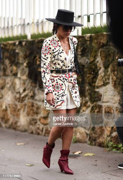 Guest is seen wearing a floral jacket outside the Loewe show during Paris Fashion Week SS20 on September 27, 2019 in Paris, France.