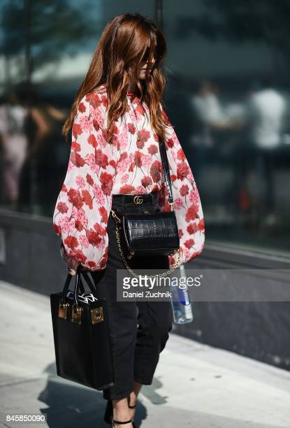A guest is seen wearing a floral top outside the 31 Phillip Lim show show during New York Fashion Week Women's S/S 2018 on September 11 2017 in New...