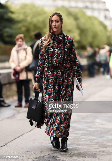 Guest is seen wearing a floral Valentino outfit outside the Valentino show during Paris Fashion Week SS20 on September 29, 2019 in Paris, France.