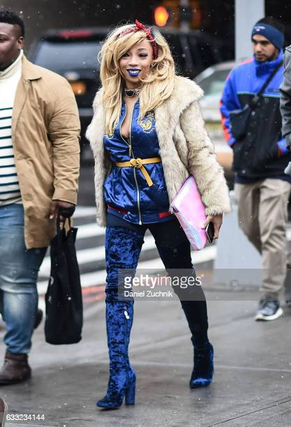 A guest is seen wearing a fur coat blue jacket and blue velvet boots outside of the Carlos Campos show during New York Fashion Week Men's AW17 on...