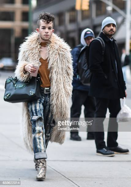 A guest is seen wearing a fur coat brown top Hood by Air jeans snake skin boots and black bag outside of the General Idea show during New York...