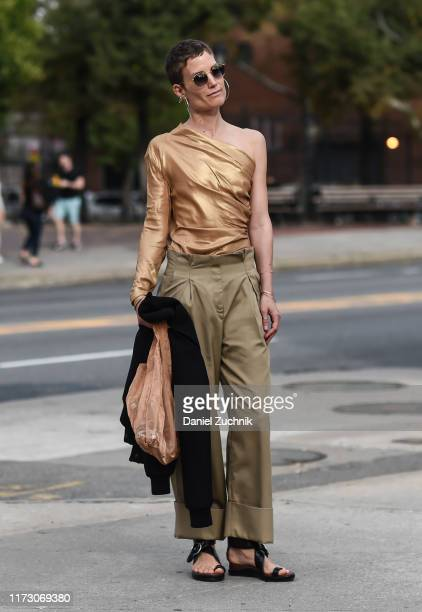A guest is seen wearing a gold top and beige pants outside the Area show during New York Fashion Week S/S20 on September 07 2019 in New York City