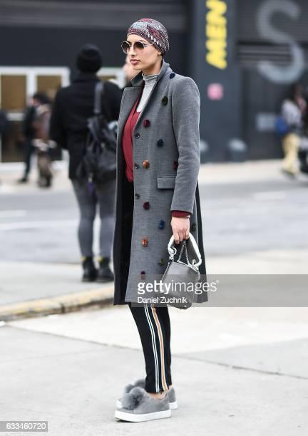 A guest is seen wearing a gray coat with fur specks outside of the Rochambeau show during New York Fashion Week Men's AW17 on February 1 2017 in New...