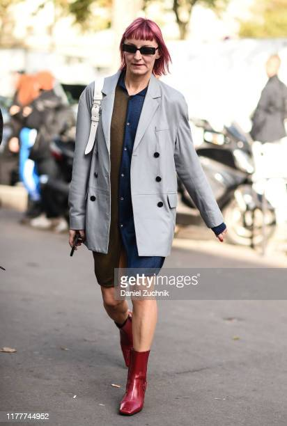 Guest is seen wearing a gray jacket and red boots outside the Haider Ackermann show during Paris Fashion Week SS20 on September 28, 2019 in Paris,...
