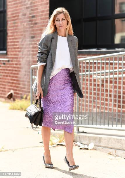 Guest is seen wearing a gray jacket, white top, purple skirt and black bag outside the Phillip Lim show during New York Fashion Week S/S20 on...