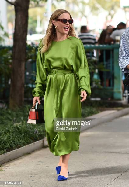 Guest is seen wearing a green dress and blue shoes outside the Longchamp show during New York Fashion Week S/S20 on September 07, 2019 in New York...
