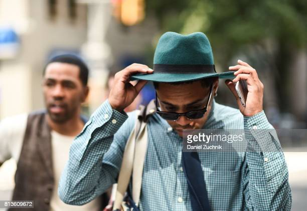 Guest is seen wearing a green hat outside the Matiere show during New York Fashion Week: Men's S/S 2018 at Skylight Clarkson Sq on July 12, 2017 in...
