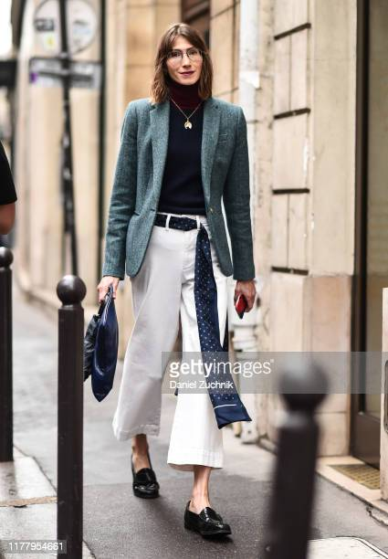 Guest is seen wearing a green jacket, blue sweater, white pants and a Thom Browne belt outside the Thom Browne show during Paris Fashion Week SS20 on...
