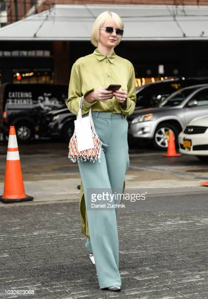 A guest is seen wearing a green shirt teal pants outside the Michael Kors show during New York Fashion Week Women's S/S 2019 on September 12 2018 in...