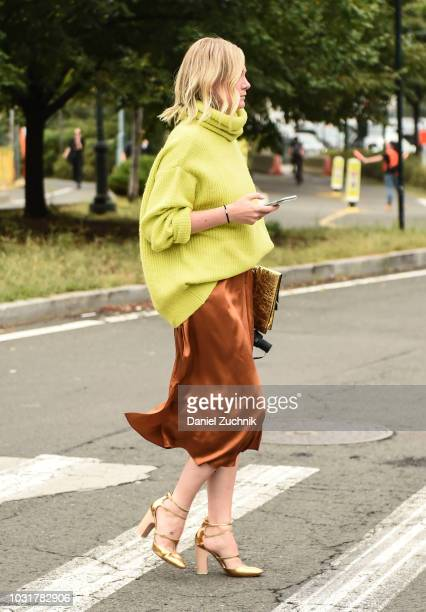 A guest is seen wearing a green sweater and gold skirt outside the Coach 1941 show during New York Fashion Week Women's S/S 2019 on September 11 2018...