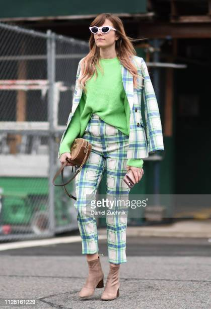 A guest is seen wearing a green top checkered jacket with pants and beige booties outside the Tadashi Shoji show during New York Fashion Week Women's...