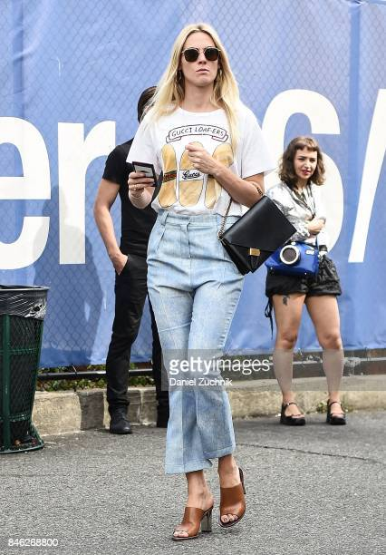 A guest is seen wearing a Gucci shirt outside the Coach show during New York Fashion Week Women's S/S 2018 on September 12 2017 in New York City