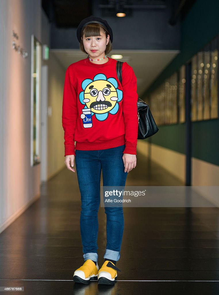 A guest is seen wearing a hat by Ferugi, sweatshirt by Ryota Murakami, trousers by Uniqlo and shoes by Fessura during the Mercedes Benz Fashion Week TOKYO 2015 A/W at Shibuya Hikarie on March 19, 2015 in Tokyo, Japan.