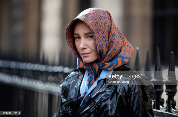 Guest is seen wearing a head scarf outside Paco Rabanne during Paris Fashion Week - Womenswear Fall/Winter 2020/2021 : Day Four on February 27, 2020...