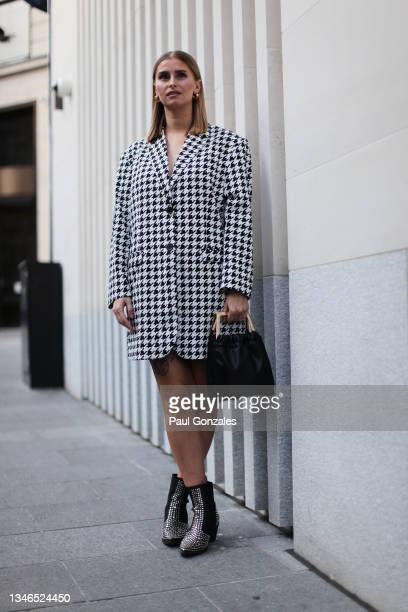 Guest is seen wearing a Houndstooth Black & White Check Blazer at Richard Quinn, during London Fashion Week September 2021 on September 21, 2021 in...