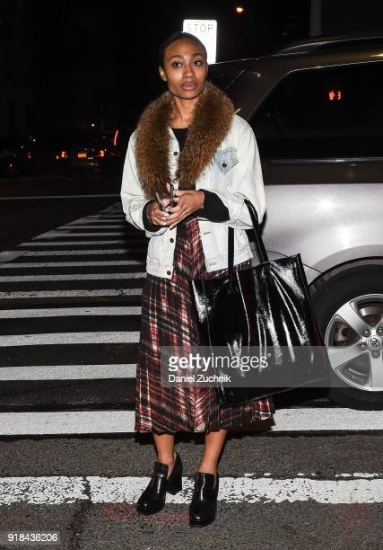 A guest is seen wearing a jacket with brown fur trim and Marc Jacobs skirt outside the Marc Jacobs show during New York Fashion Week Women's A/W 2018...