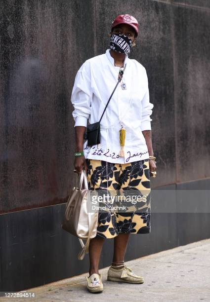 A guest is seen wearing a Jacquemus shirt Phillip Lim shorts and a Telfar bag outside the Studio 189 show during New York Fashion Week S/S21 on...