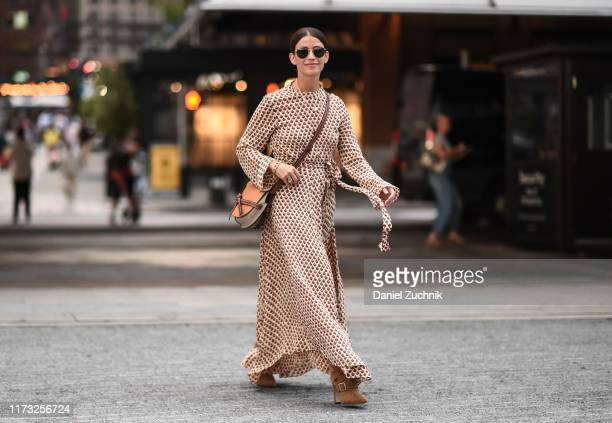 A guest is seen wearing a Jason Wu dress outside the Jason Wu show during New York Fashion Week S/S20 on September 08 2019 in New York City