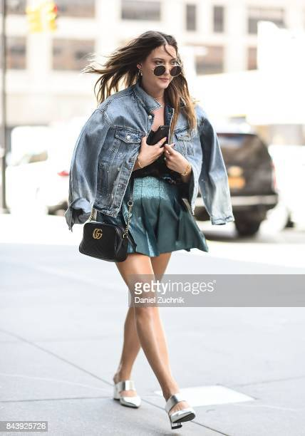 A guest is seen wearing a jean jacket with green skirt outside the Noon by Noor show during New York Fashion Week Women's S/S 2018 at Skylight...