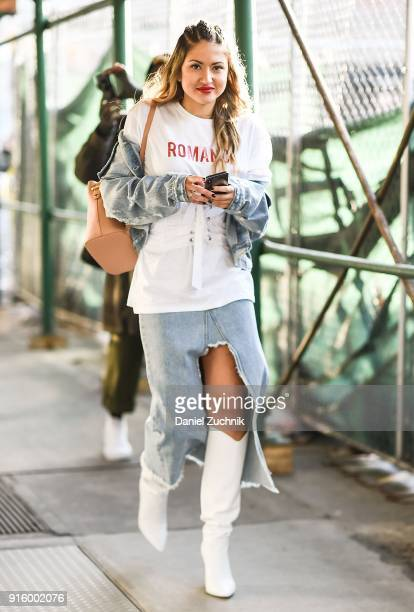 A guest is seen wearing a jeans skirt and white boots outside the Tadashi Shoji show during New York Fashion Week Women's A/W 2018 on February 8 2018...