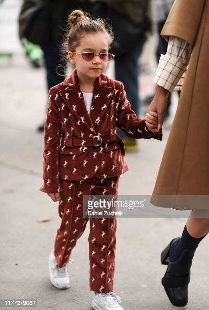 Guest is seen wearing a kids Chloe suit outside the Chloe show during Paris Fashion Week SS20 on September 26, 2019 in Paris, France.