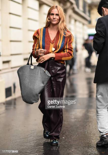 Guest is seen wearing a Lanvin sweater and maroon leather pants with a gray bag at the Lanvin show during Paris Fashion Week SS20 on September 25,...