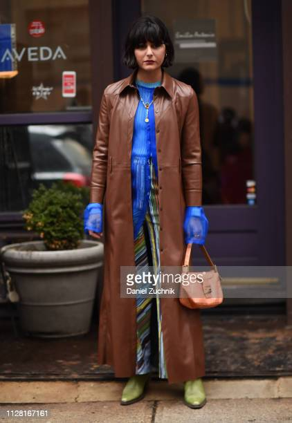 A guest is seen wearing a leather coat and blue top with striped pants outside the Maryam Nassir Zadeh show during New York Fashion Week Women's...