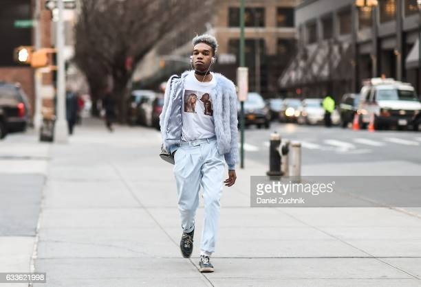 A guest is seen wearing a light blue fur jacket and light blue pants outside of the General Idea show during New York Fashion Week Men's AW17 on...