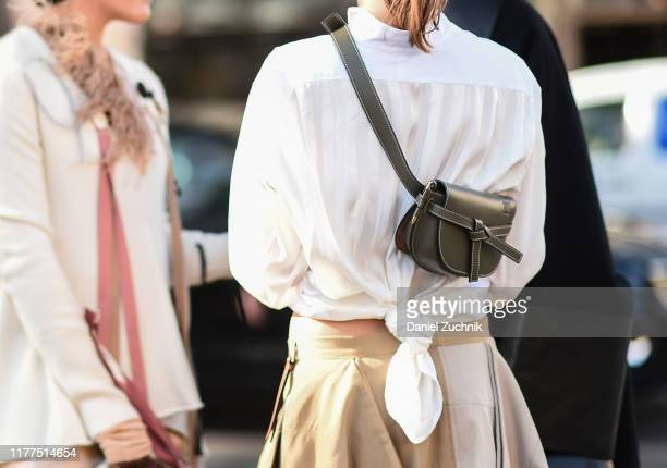 Guest is seen wearing a Loewe green bag outside the Loewe show during Paris Fashion Week SS20 on September 27, 2019 in Paris, France.