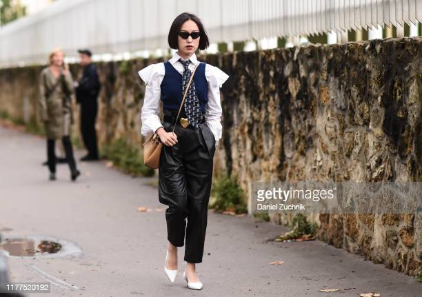 A guest is seen wearing a Loewe outfit outside the Loewe show during Paris Fashion Week SS20 on September 27 2019 in Paris France