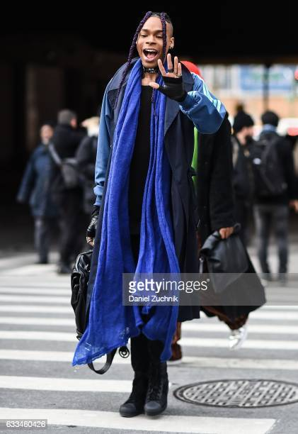 A guest is seen wearing a long blue scarf outside of the Nautica show during New York Fashion Week Men's AW17 on February 1 2017 in New York City