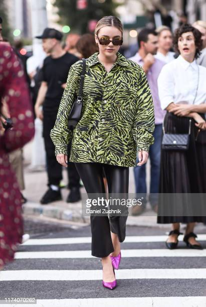 A guest is seen wearing a Marc Jacobs animal print top and black leather pants outside the Marc Jacobs show during New York Fashion Week S/S20 on...