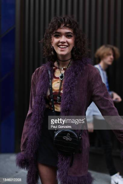 Guest is seen wearing a Mauve Sheepskin with a Vivienne Westwood Bag at Richard Quinn, during London Fashion Week September 2021 on September 21,...